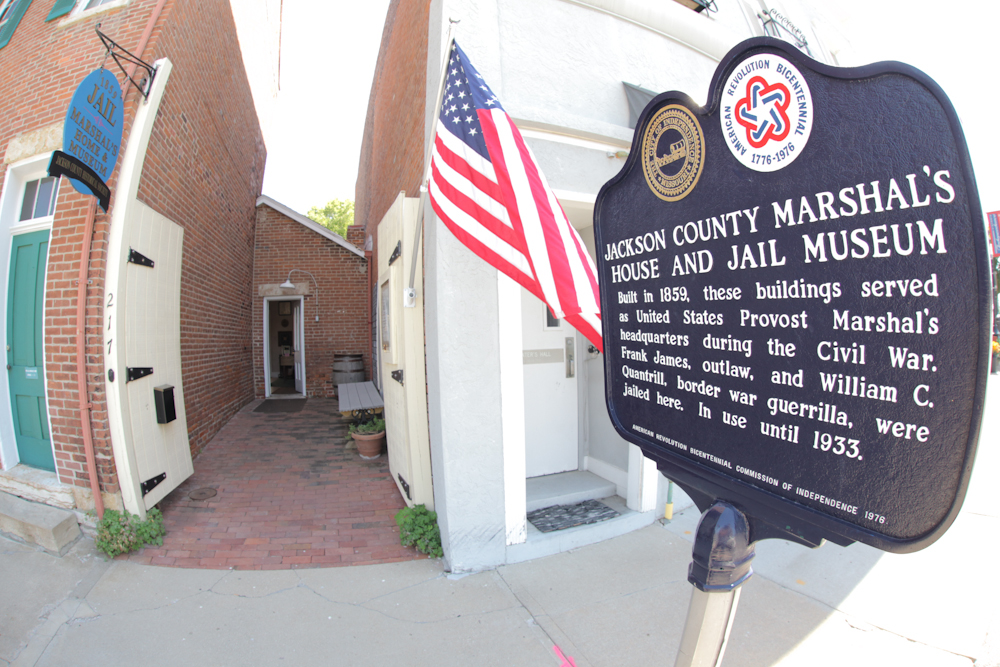 Entrance to the 1859 Jail, Marshal's Home & Museum, with the historical marker
