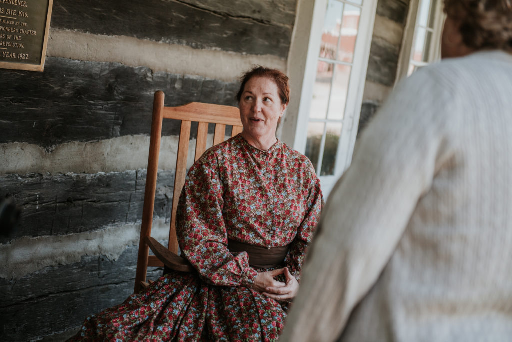 A historical interpreter greets guests at the 1827 Log Courthouse in Independence, MO
