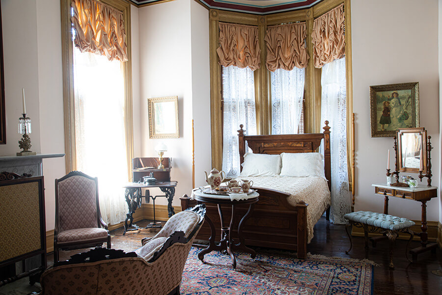 A guest bedroom in the Vaile Mansion in Independence, MO