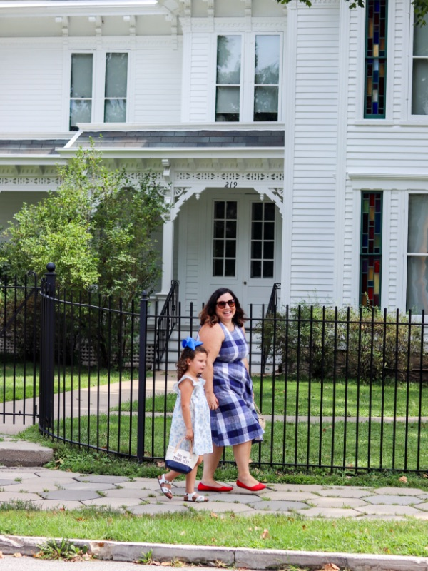 Influencer Jen Cowan and her daughter, Hattie, walk outside of the Harry S. Truman home in Independence, MO