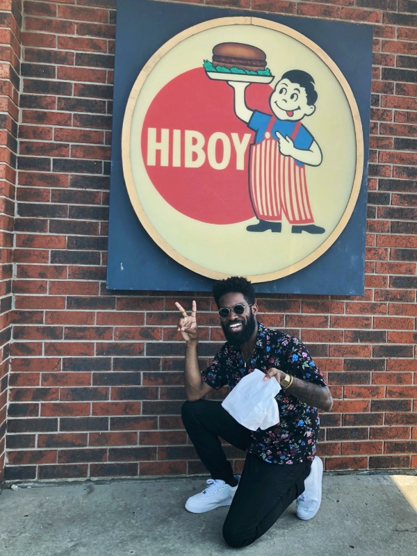 Influencer Jon Marzette poses by the sign at HiBoy Drive-In in Independence, MO