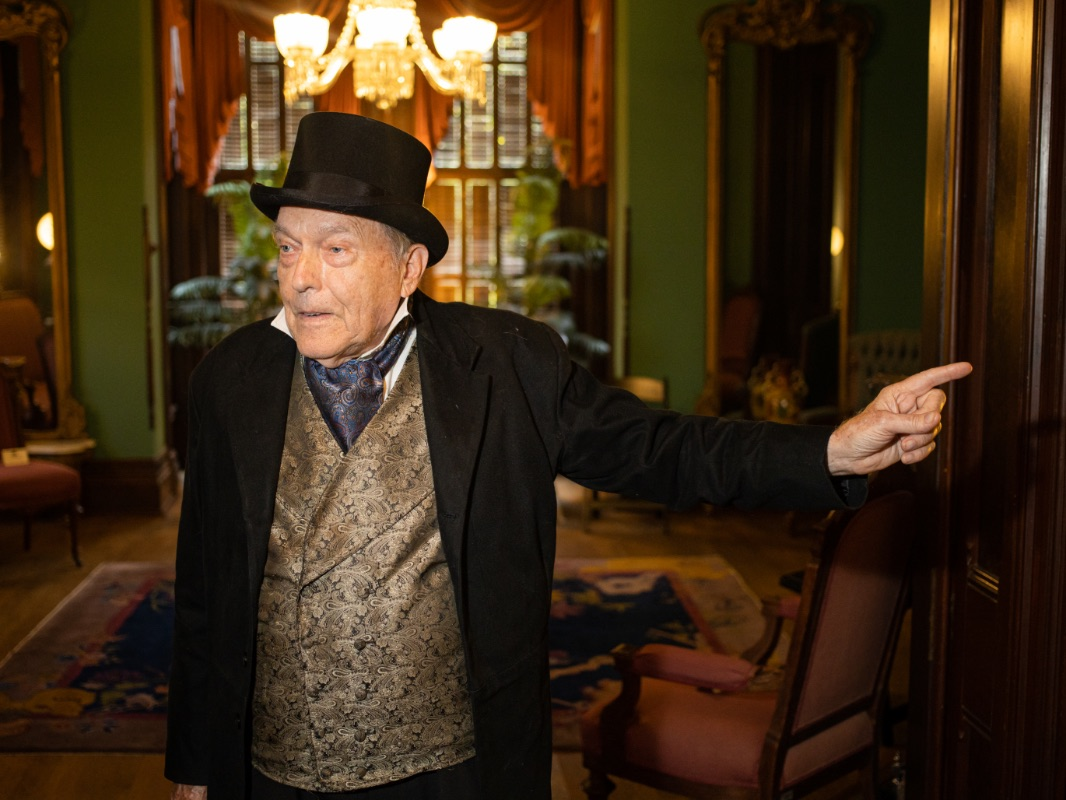 A tour guide in period costume at the Vaile Mansion in Independence, MO