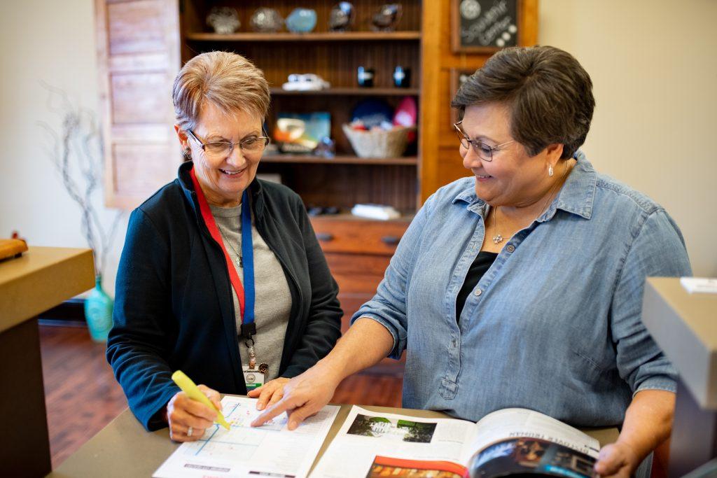 Volunteers Looking at Visitor Guide
