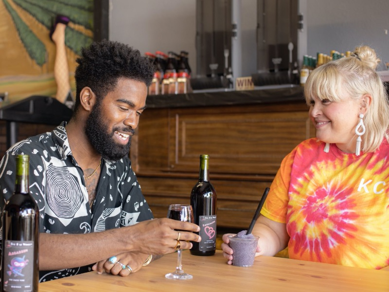 Influencer Jon Marzette and his girlfriend, Ann, sample wine at Tophat Winery in Independence, MO