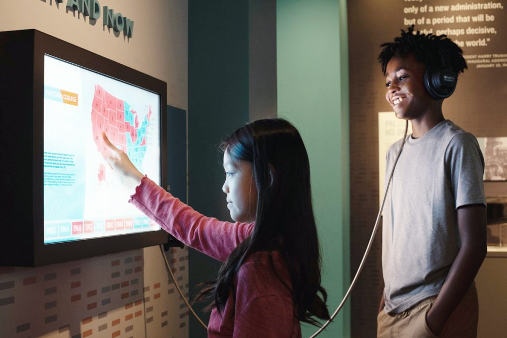 Young visitors experience an interactive element in the Truman Library.