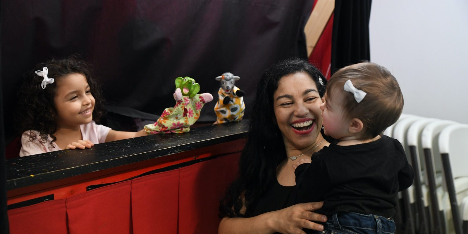 Elayna Fernández and her daughters put on a puppet show at the Puppetry Arts Institute in Independence, MO