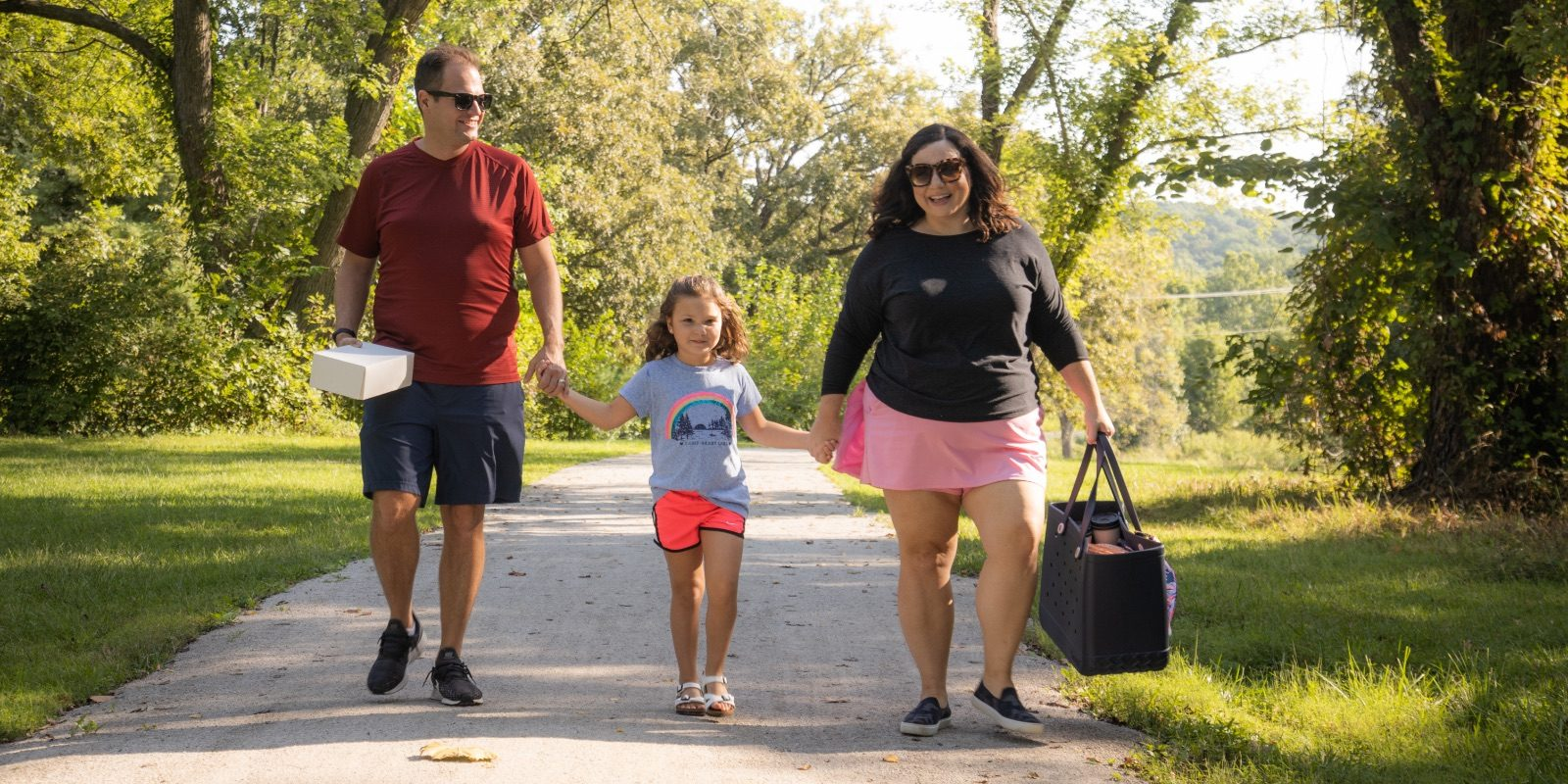 Influencer Jen Cowan and her family walk through Waterfall Park in Independence, MO