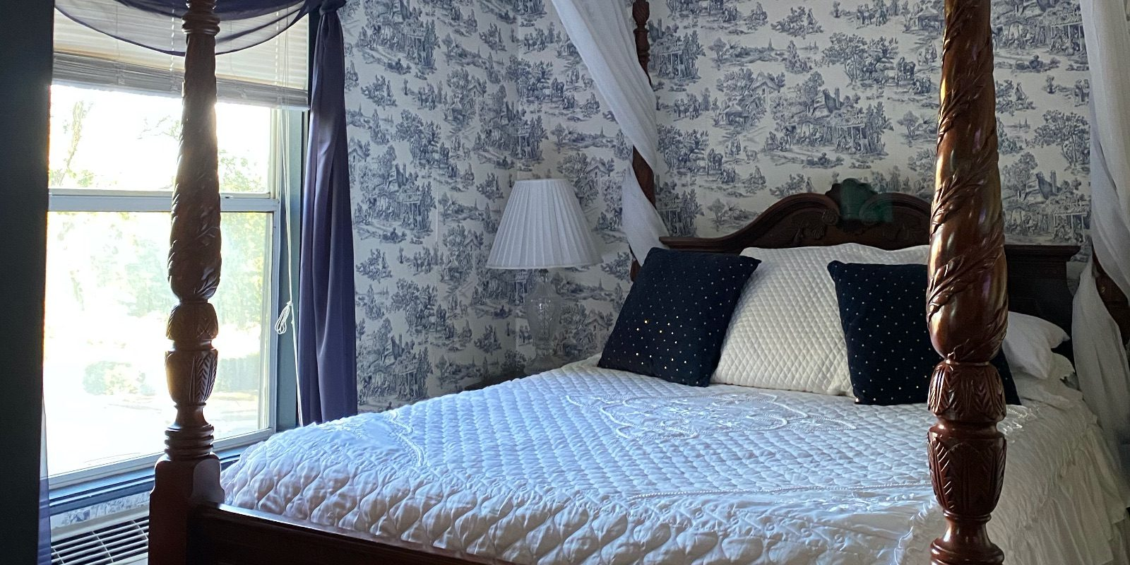 A bed inside the English Spa suite at the Woodstock Inn Bed & Breakfast in Independence, MO